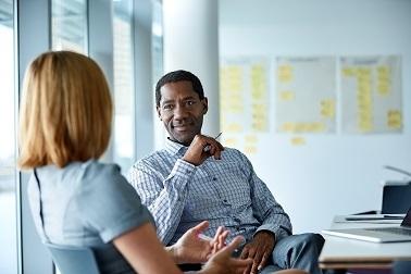 Skin health employees in meeting room